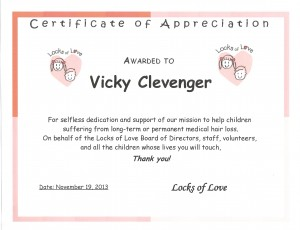 Vicky with Arctic Comfort Air Conditioning and Heating, Locks of Love Certificate of Appreciation 11 19 13 for hair donation